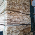Tall stack of lumber at Industrial Lumber warehouse