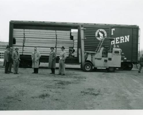 Old railroad car full of lumber at Industrial Lumber & Plywood in Minneapolis, Minnesota
